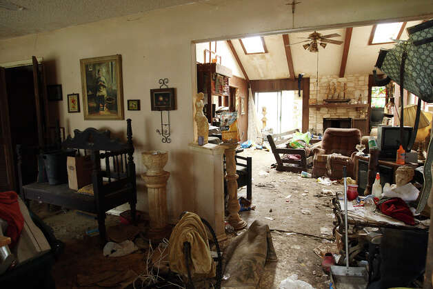 A view of the living room of a house in the Geronimo Forest subdivision of far West Bexar County, Thursday, May 31, 2012. A woman in her seventies was recently removed from the house. The house is full of animal feces and several cats are roaming the area. Neighbors have complained of the living condition of the resident but they said no action was taken by adult protection agencies. Photo: Jerry Lara, San Antonio Express-News / © 2012 San Antonio Express-News