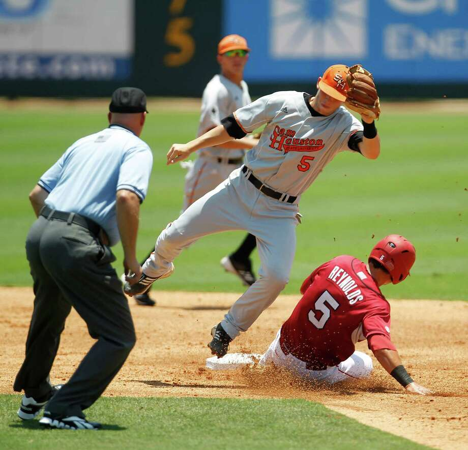 Arkansas Matt Reynolds (5) steals second base from Sam Houston's Jessie Plumlee (5) in the first inning during a college baseball game at the Houston Regional at Rice University, Friday, June 1, 2012, in Houston. Arkansas won the game against Sam Houston 5-4. Photo: Karen Warren, Houston Chronicle / © 2012  Houston Chronicle