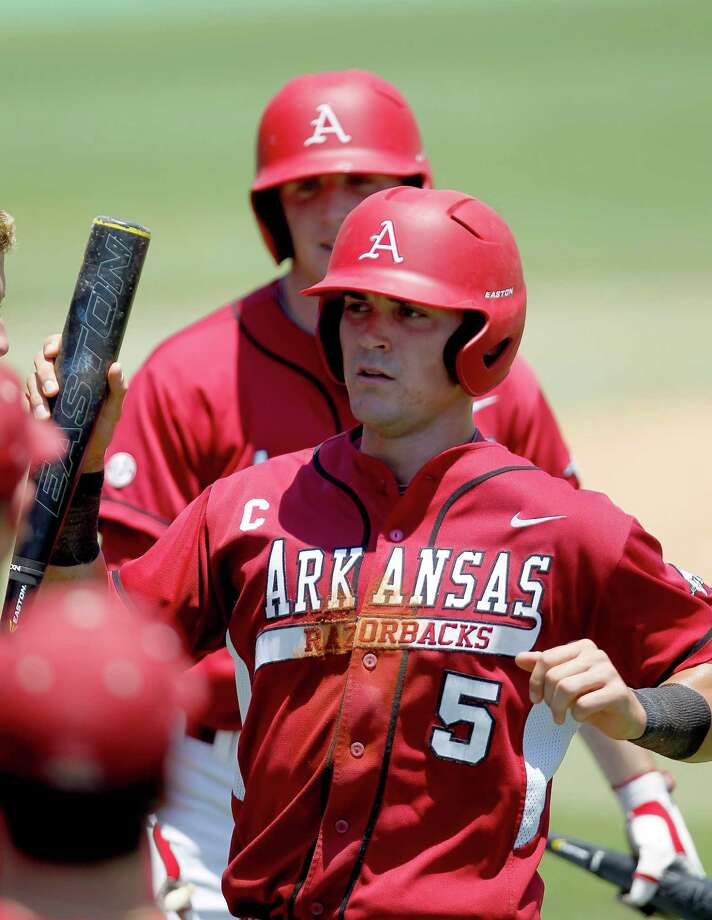 Arkansas' Matt Reynolds (5) celebrates his run scored on a sac fly by Derrick Bleeker in the 4th inning during a college baseball game at the Houston Regional at Rice University, Friday, June 1, 2012, in Houston. Arkansas won the game against Sam Houston 5-4. Photo: Karen Warren, Houston Chronicle / © 2012  Houston Chronicle