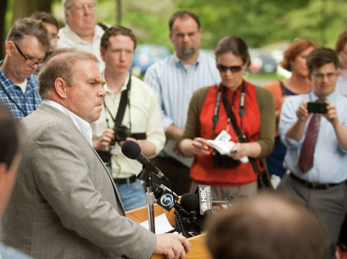 Tom Swan, left, campaign manager for Speaker of the House Christopher Donovan, Democratic candidate for Connecticut's 5th Congressional District, addresses the media after a campaign staff member was arrested by the FBI earlier in the week, Friday, June 1, 2012 outside the Capitol in Hartford, Conn. An FBI investigation into the finances of his congressional campaign will not keep Christopher Donovan from running or force him to step down as the Connecticut House speaker, his campaign manager said Friday.
