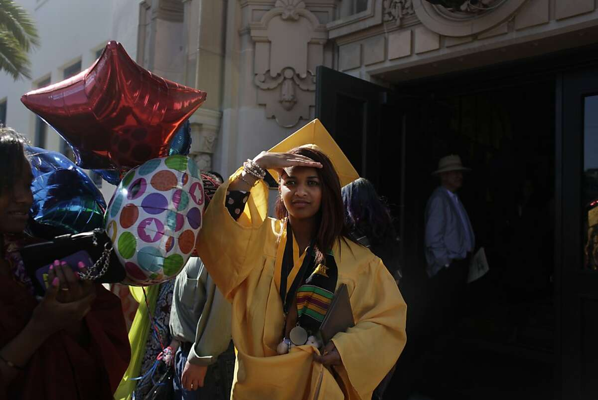 Makda Beyene searches for her mother in the crowd of attendees from the Mission High School Class of 2012 Commencement Exercises from the front steps of Mission High School on Wednesday, May 23, 2012 in San Francisco, Calif.