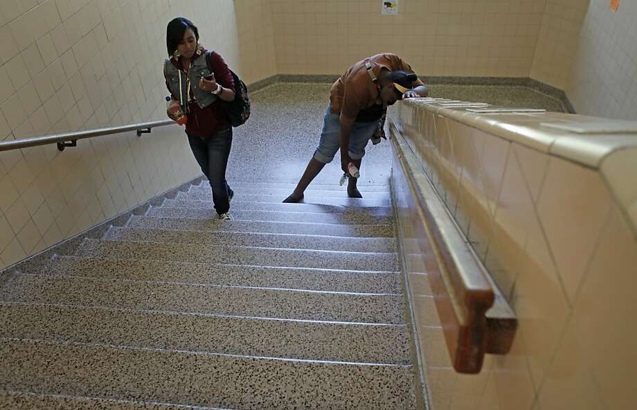 "Seventh grader Taeylor Baker, right, stops to take a breath as she and Aniyah McWoodson  climb up the stairs at school,  Wednesday May 30, 2012, in Oakland, Calif. Taeylor with the support of her grandmother Karen slider has lost 15 pounds since November when she enrolled in the Oakland Children's  Hospital's ""Healthy Heart"" program. Photo: Lacy Atkins, The Chronicle"