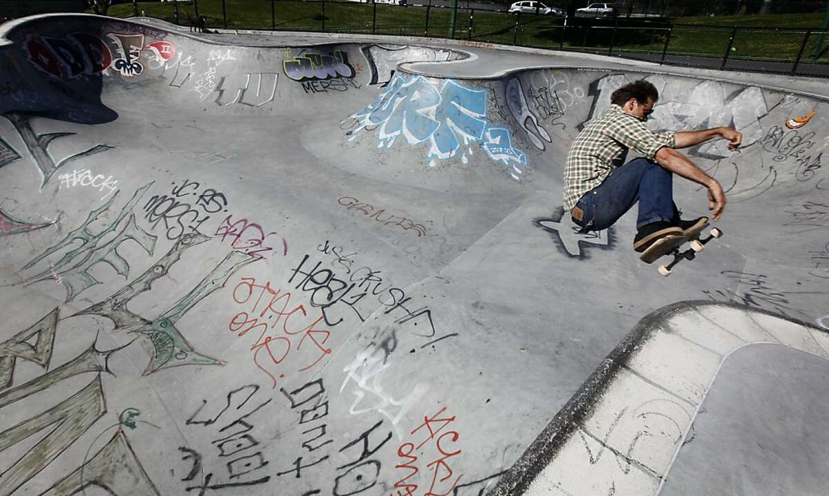 Bob Lake rides his board on the graffiti-covered skateboard park at Potrero del Sol Park in San Francisco, Calif. on Friday, June 1, 2012. The city spends thousands of dollars annually to repair damage to parks caused by vandals.