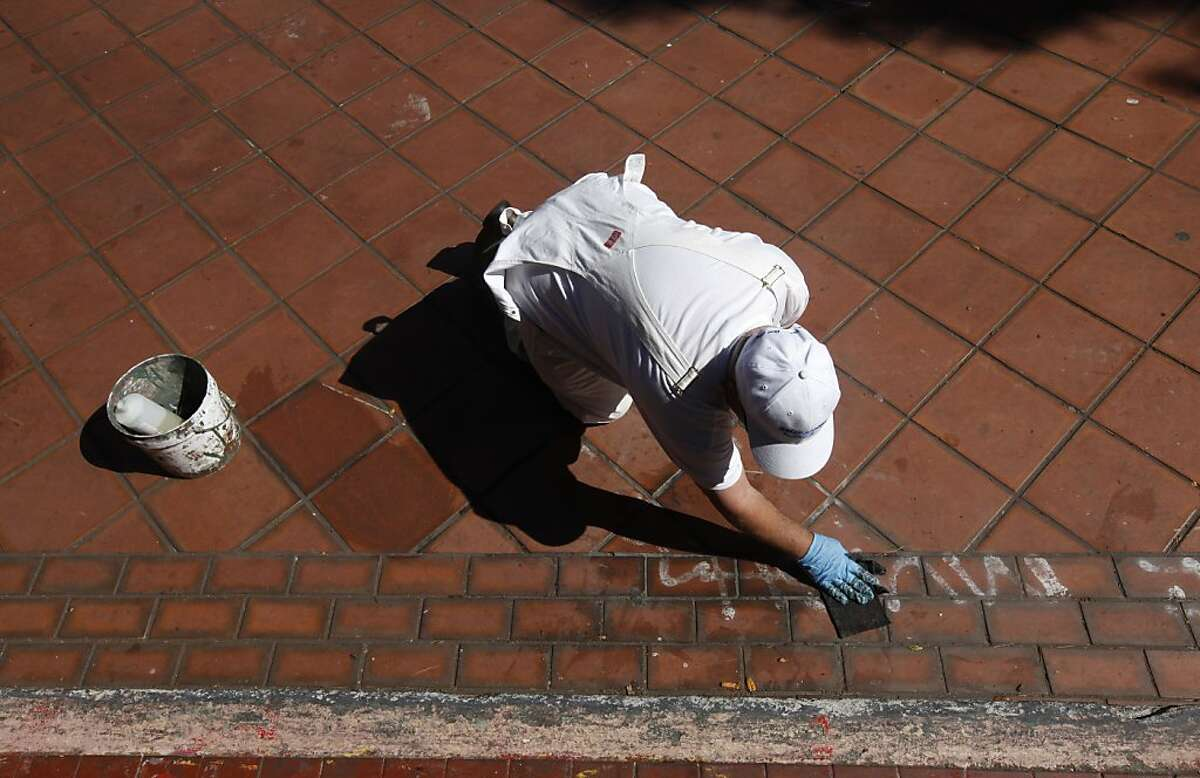 John T., a painter with the Recreation and Park Department, removes graffiti at Potrero del Sol Park in San Francisco, Calif. on Friday, June 1, 2012. The city spends thousands of dollars annually to repair damage to parks caused by vandals.