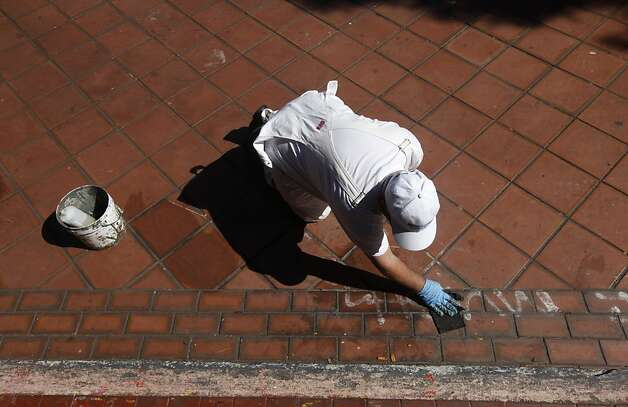 John T., a painter with the Recreation and Park Department, removes graffiti at Potrero del Sol Park in San Francisco, Calif. on Friday, June 1, 2012. The city spends thousands of dollars annually to repair damage to parks caused by vandals. Photo: Paul Chinn, The Chronicle