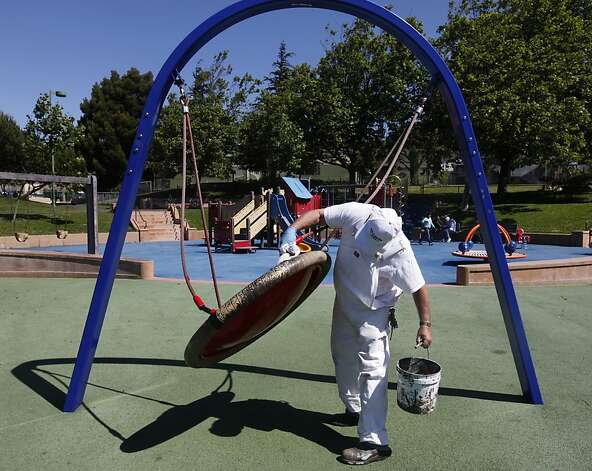 John T., a painter with the Recreation and Park Department, checks playground equipment for graffiti at Potrero del Sol Park in San Francisco, Calif. on Friday, June 1, 2012. The city spends thousands of dollars annually to repair damage to parks caused by vandals. Photo: Paul Chinn, The Chronicle