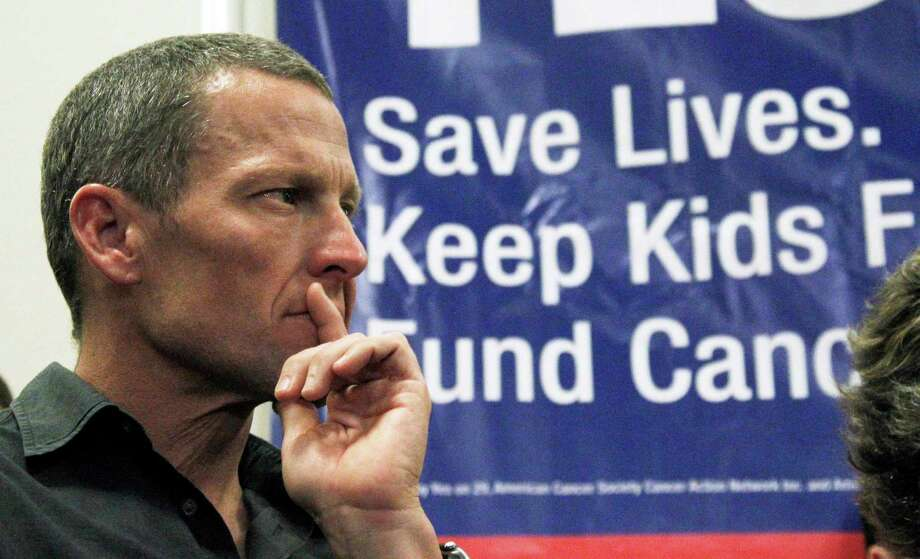 Lance Armstrong attends a rally last month at Children's Hospital in Los Angeles in favor of a measure that would add a $1-per-pack tax on cigarettes. Photo: Reed Saxon / AP2012