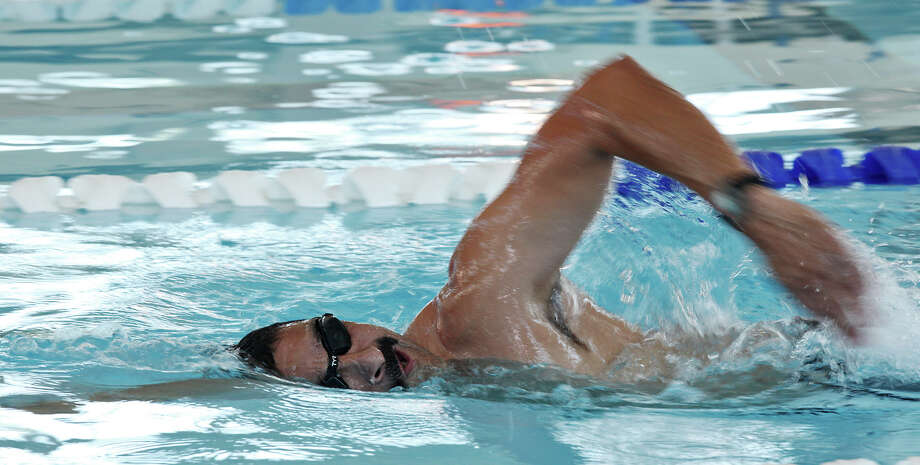 San Antonio Police Department Detective Carlos Ortiz swims at the Northside Natatorium, Monday, May 28, 2012. Ortiz is training to compete in the Escape from Alcatraz Triathlon on June 10. The race consists o a 1.5 swim from Alcatraz Island to the shore followed by an 18-mile bike ride and ends with an 8 mile run. Photo: Jerry Lara, Staff / © 2012 San Antonio Express-News