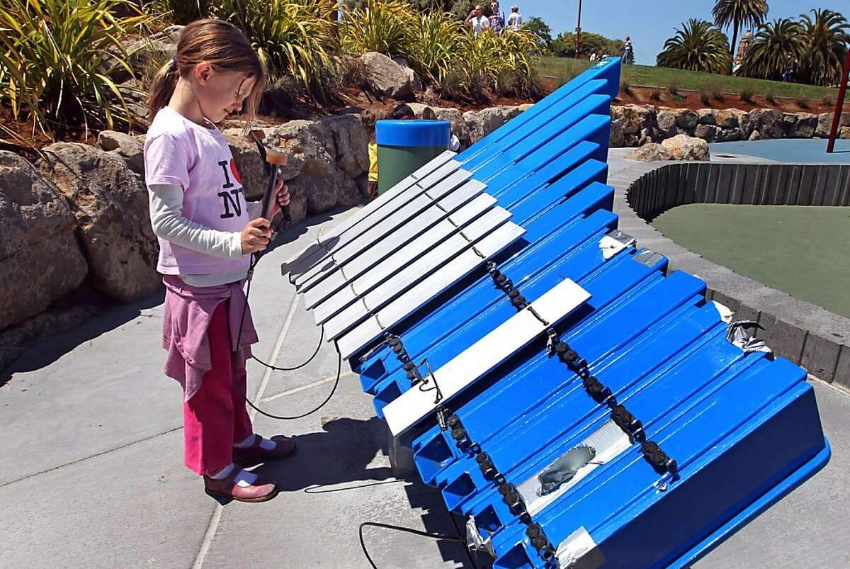 Maggie Leu 6 plays the lower notes of the xylophone. San Francisco new children?•s playground inside Dolores Park, recently celebrated it?•s grand opening. Not long after that, vandals damaged the cool xylophone in the music area. Six or so of the 14 keys have gone missing, making it less fun to play. Vandals also etched the tops of the drums. Not far from there, by one of the