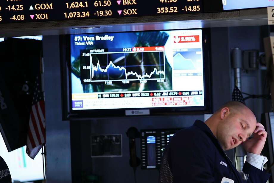 NEW YORK, NY - JUNE 01: A trader works on the floor of the New York Stock Exchange on June 1, 2012 in New York City. Following a poor jobs report, U.S. stocks sank more than 2% with the Dow Jones industrial average falling 277 points, or 2.2%. (Photo by Spencer Platt/Getty Images) Photo: Spencer Platt, Getty Images