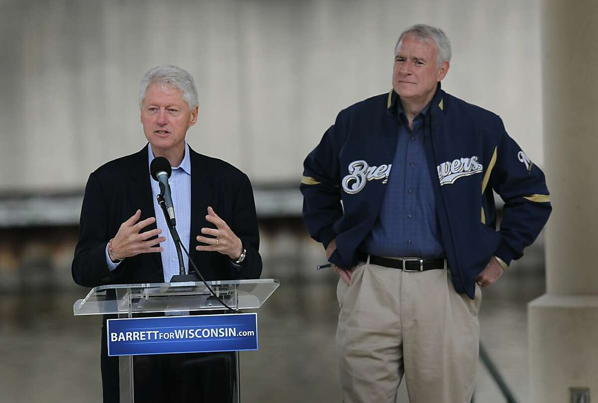 MILWAUKEE, WI - JUNE 01: Former President Bill Clinton campaigns for Milwaukee Mayor Tom Barrett (R) at a ''Get Out The Vote'' Rally as Barrett tries to unseat Wisconsin Governor Scott Walker in a recall election on June 1, 2012 in Milwaukee, Wisconsin. Opponents of Walker forced a recall election after the governor pushed to change the collective bargaining process for public employees in the state. The election is scheduled for June 5. (Photo by Scott Olson/Getty Images)