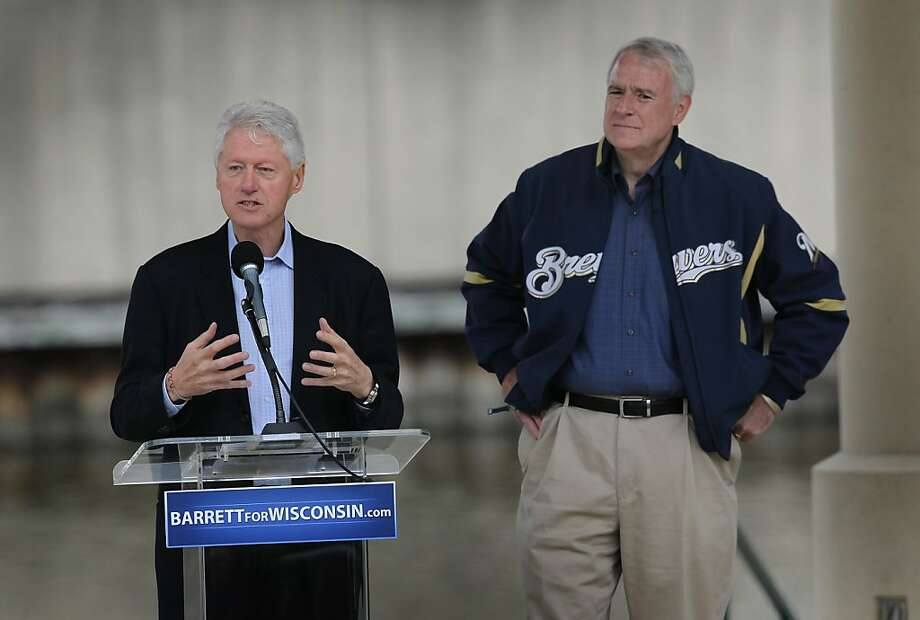 MILWAUKEE, WI - JUNE 01: Former President Bill Clinton campaigns for Milwaukee Mayor Tom Barrett (R) at a ''Get Out The Vote'' Rally as Barrett tries to unseat Wisconsin Governor Scott Walker in a recall election on June 1, 2012 in Milwaukee, Wisconsin. Opponents of Walker forced a recall election after the governor pushed to change the collective bargaining process for public employees in the state. The election is scheduled for June 5. (Photo by Scott Olson/Getty Images) Photo: Scott Olson, Getty Images