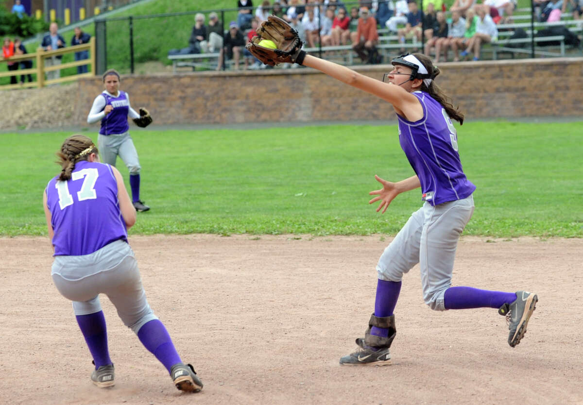 Westhill first-baseman Meg D'Allesandro makes a catch in the infield during Friday's softball game against Mercy in Stamford on June 1, 2012.