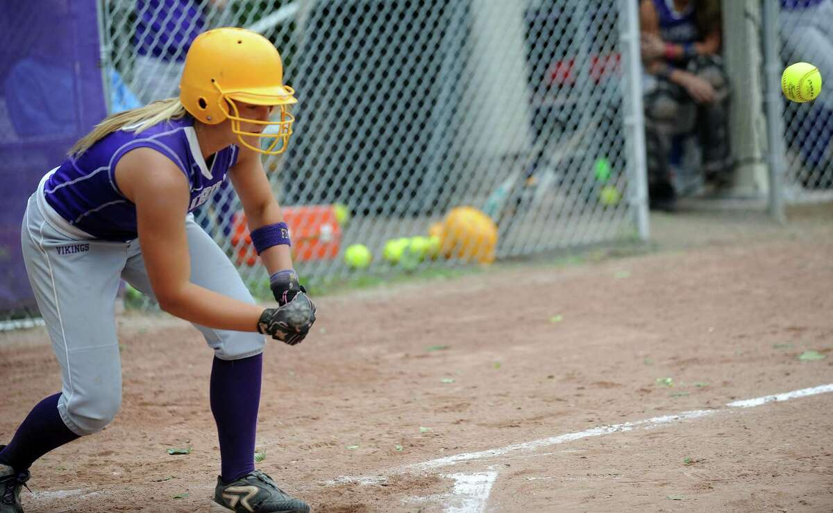 Westhill's Allison Macari reaches to bunt during Friday's softball game against Mercy in Stamford on June 1, 2012.