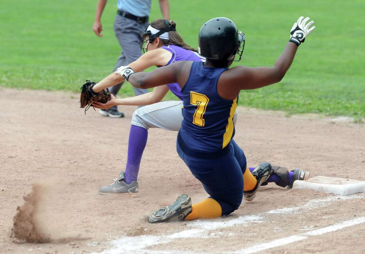 Westhill first-baseman Meg D'Allesandro gets an out as Mercy's Christie Idiong slides into the base during Friday's softball game against Mercy in Stamford on June 1, 2012.