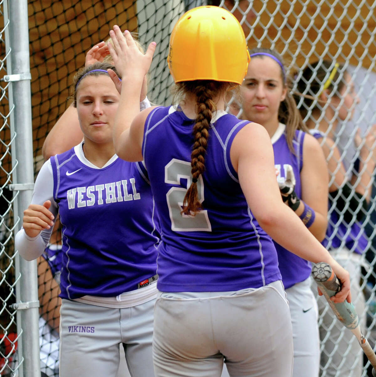 Westhill's Tami Wise gets high-fives after scoring a run during Friday's softball game against Mercy in Stamford on June 1, 2012.