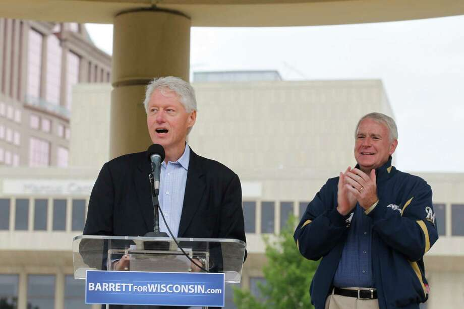 Former President Bill Clinton, left, speaks on behalf of Democratic candidate for Wisconsin Gov. Tom Barrett, right, at a recall election rally Friday, June 1, 2012, in Milwaukee. Clinton urged hundreds of Wisconsin Democrats to vote out Republican Gov. Scott Walker in next week?s recall election because he refused to govern through compromise and honest negotiation.  (AP Photo/Jeffrey Phelps) Photo: Jeffrey Phelps / FR59249 AP