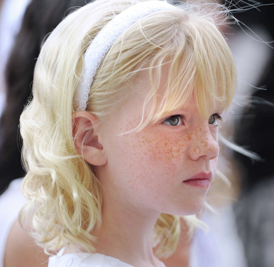 Flower girl Maddy Sieg, 8, during the Convent of the Sacred Heart graduation in Greenwich, Friday, June 1, 2012. Sieg is a second-grade student at the school. Photo: Bob Luckey / Greenwich Time