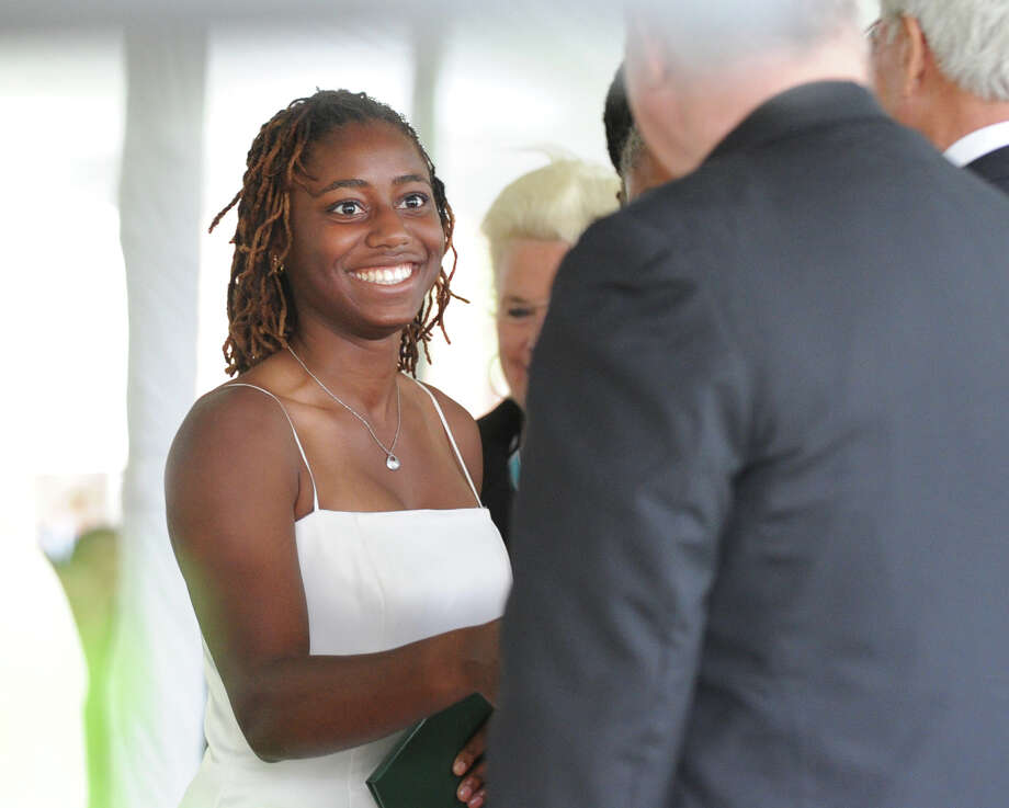 India Knight, 17, of Norwalk, receives her diploma during the Convent of the Sacred Heart graduation in Greenwich, Friday, June 1, 2012. Photo: Bob Luckey / Greenwich Time
