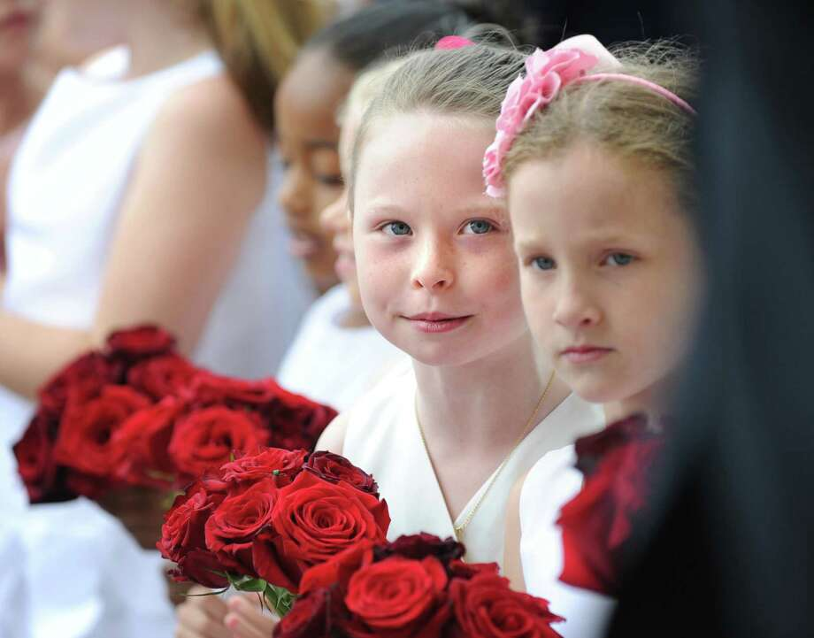 Flower girl Regina Finn, 8, left, during the Convent of the Sacred Heart graduation in Greenwich, Friday, June 1, 2012. Finn is a second-grade student at the school. Photo: Bob Luckey / Greenwich Time