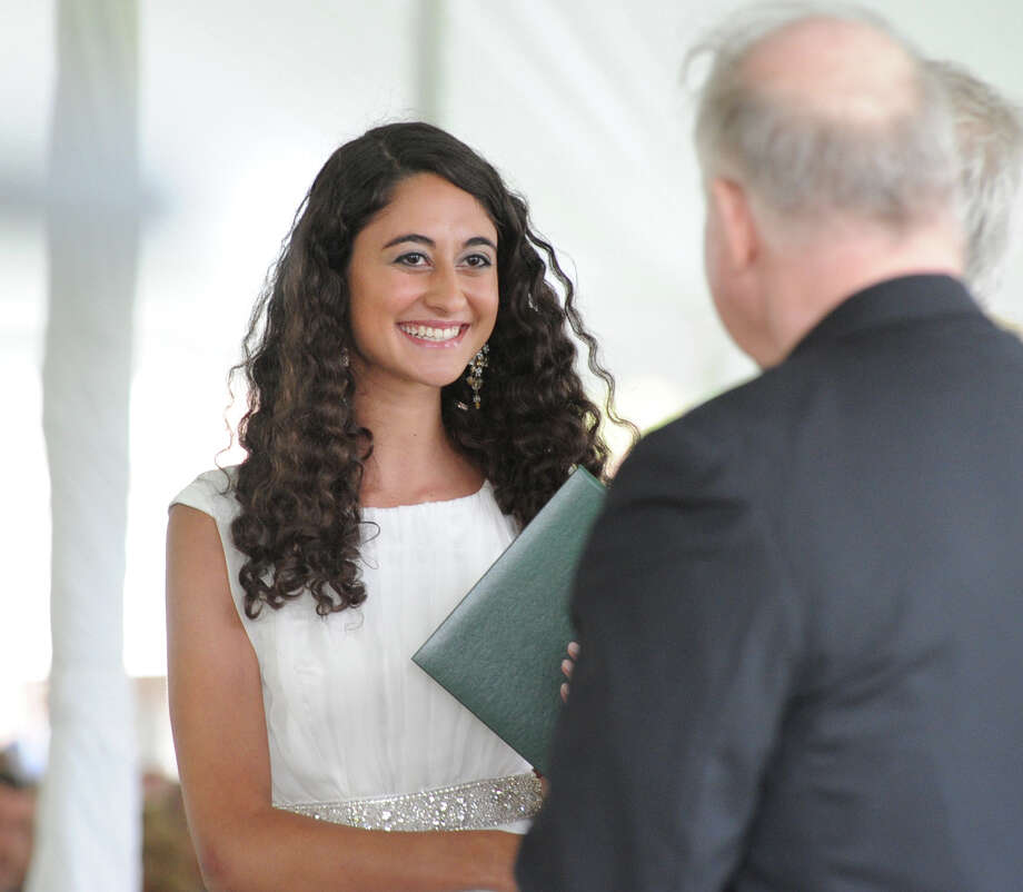 Co-valedictorian Claudia Khoury receives her diploma during the Convent of the Sacred Heart graduation in Greenwich, Friday, June 1, 2012. The other valedictorian was Catherine Colford. Photo: Bob Luckey / Greenwich Time