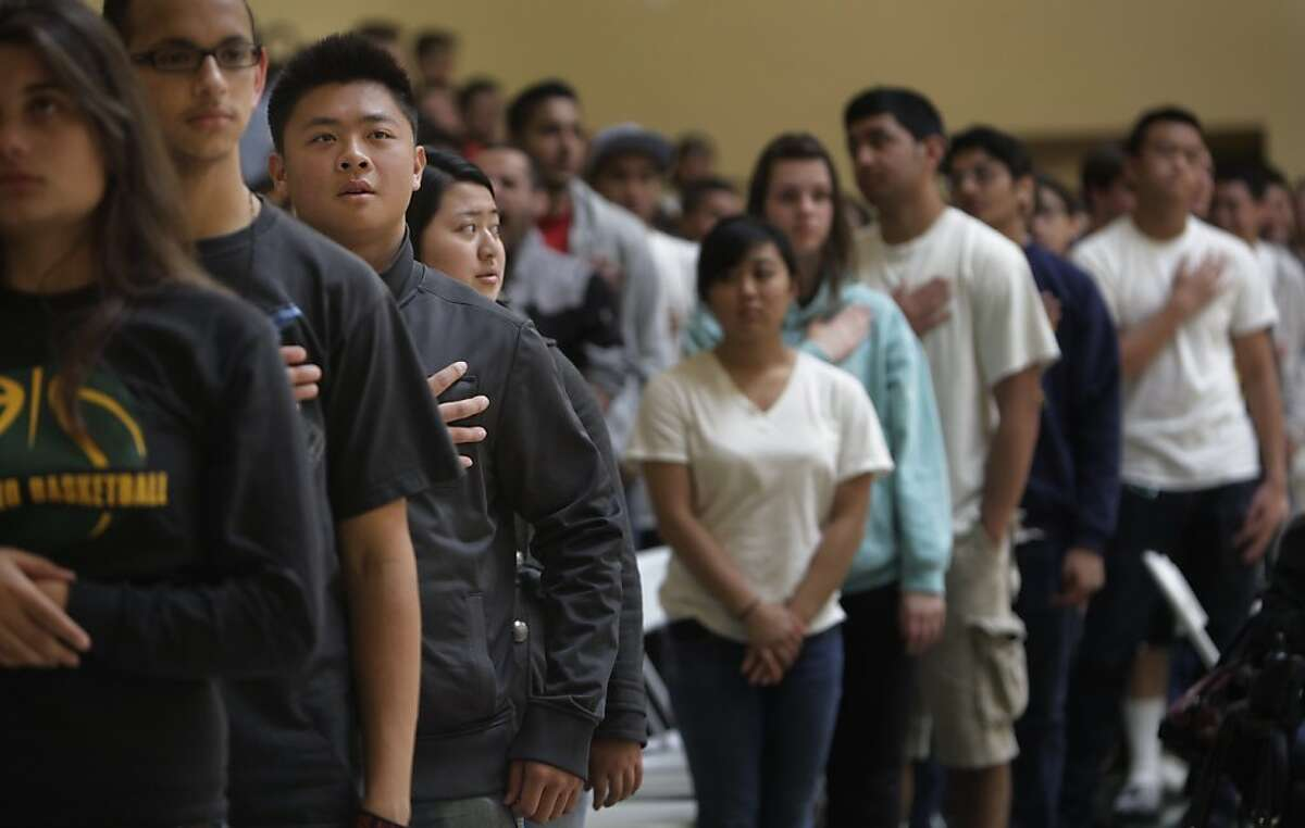 Capuchino High School senior Max Mak (third from left) says the Pledge of Allegiance with other graduating seniors as he attends graduation rehearsal in the gym at Capuchino High School on Wednesday, May 30, 2012 in San Bruno, Calif.