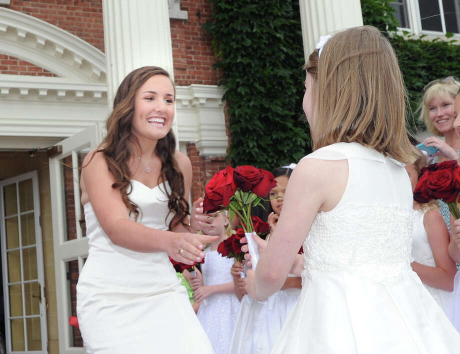 Graduating senior Alexandra Wales, left, during the Convent of the Sacred Heart graduation in Greenwich, Friday, June 1, 2012. Photo: Bob Luckey / Greenwich Time