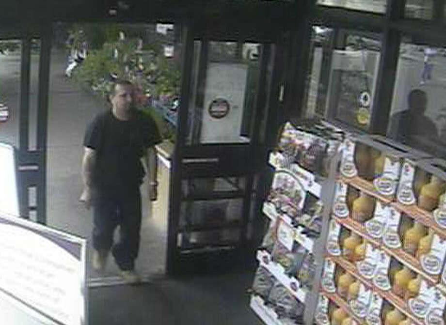 Police are trying to identify this suspect who is seen on surveillance photos using a credit card stolen from the purse of a Brookfield woman last week. Photo: Contributed Photo