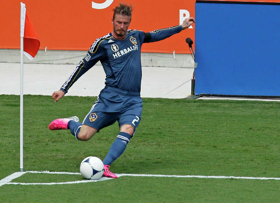 Los Angeles Galaxy midfielder David Beckham wasn't a fan of the early start time when he faced the Dynamo last week at BBVA Compass Stadium Photo: James Nielsen / © Houston Chronicle 2012