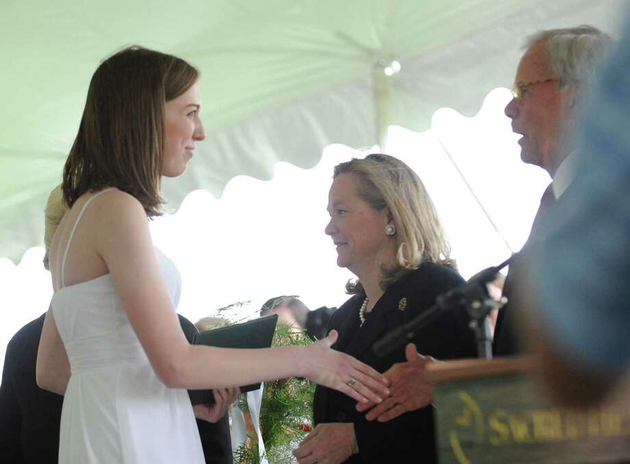 Co-valedictorian Catherine Colford shakes the hand of Tom Brokaw during the Convent of the Sacred Heart graduation in Greenwich, Friday, June 1, 2012. Photo: Bob Luckey / Greenwich Time