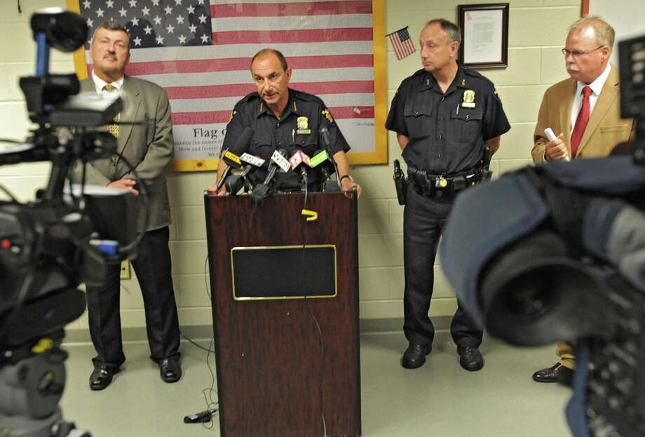 Police Chief John Tedesco speaks during a news conference at police headquarters Friday, June 1, 2012 in Troy, N.Y. City police officer Patrick Rosney, 53, of Rensselaer was arrested Friday morning by the New York Police Department on charges accusing him of committing computer crimes dangerous to minors. Also standing with him from left are Deputy Chief of Police Richard McAvoy, Assistant Chief of Police George VanBramer and Captain John Cooney. (Lori Van Buren / Times Union) Photo: Lori Van Buren