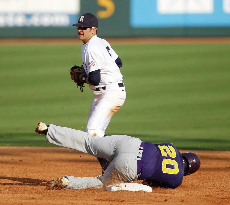 Prairie View's Evan Richard (20) lies on second base safely after a throwing error as Rice's Christian Stringer (5) tries to tag him in the 2nd inning during a college baseball game at the Houston Regional at Rice University, Friday, June 1, 2012, in Houston. Rice won the game 3-2. Photo: Karen Warren, Houston Chronicle / © 2012  Houston Chronicle
