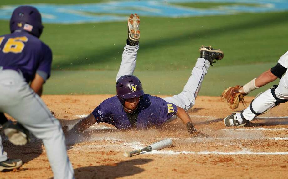 Prairie View's Stef Hernandez (10) slides into home safely on an two run double by Colby Hines (1) in the 2nd inning during a college baseball game at the Houston Regional at Rice University, Friday, June 1, 2012, in Houston. Rice won the game 3-2. Photo: Karen Warren, Houston Chronicle / © 2012  Houston Chronicle