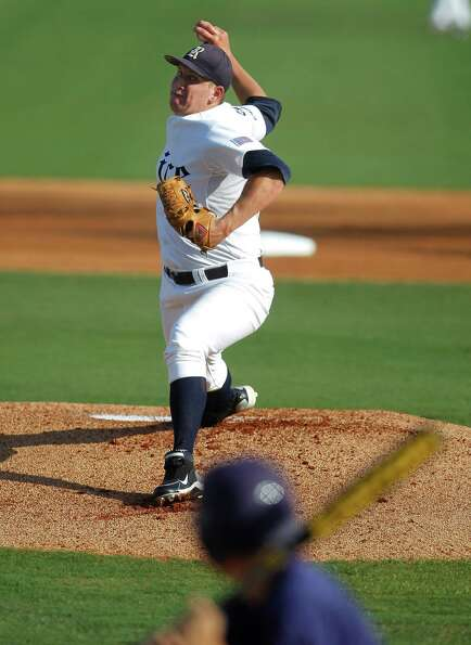 Rice starting pitcher John Simms (13) pitches in the first inning during a college baseball game at