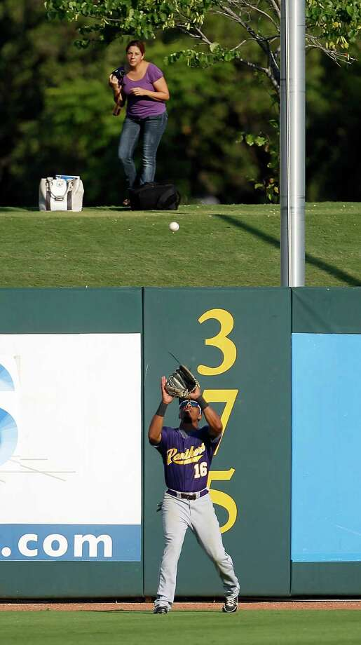 Prairie View's Darryl Johnson (16) catches a fly ball hit by Rice's Michael Ratterree (8) in the first inning during a college baseball game at the Houston Regional at Rice University, Friday, June 1, 2012, in Houston. Rice won the game 3-2. Photo: Karen Warren, Houston Chronicle / © 2012  Houston Chronicle