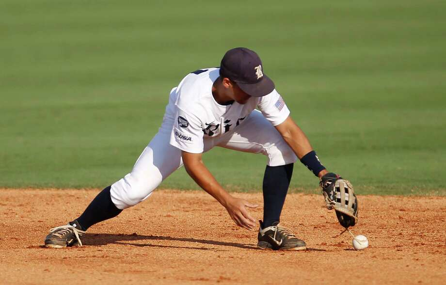 Rice's Christian Stringer (11) fumbles for the ball hit by Prairie View's Stef Hernandez (10) in the 2nd inning during a college baseball game at the Houston Regional at Rice University, Friday, June 1, 2012, in Houston. Rice won the game 3-2. Photo: Karen Warren, Houston Chronicle / © 2012  Houston Chronicle