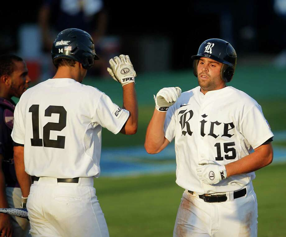 Rice's Michael Fuda (15) celebrates his solo home run with teammate J.T. Chargois (12) in the 7th inning during a college baseball game at the Houston Regional at Rice University, Friday, June 1, 2012, in Houston. Rice won the game 3-2. Photo: Karen Warren, Houston Chronicle / © 2012  Houston Chronicle