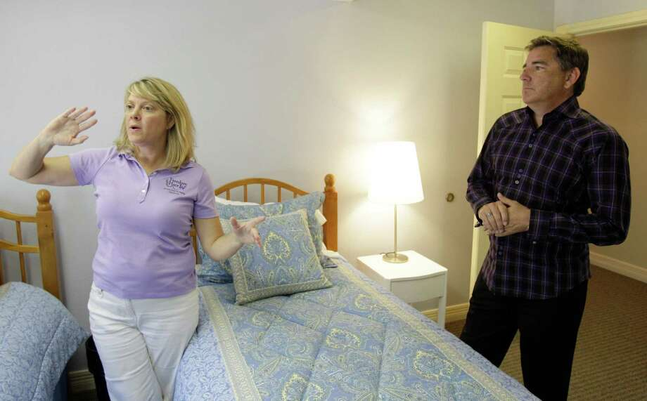 Kelly Armstrong and Mark Tennant show one of the rooms at the Christian-based care and recovery center for female victims of child sex trafficking. Photo: Melissa Phillip / © 2012 Houston Chronicle