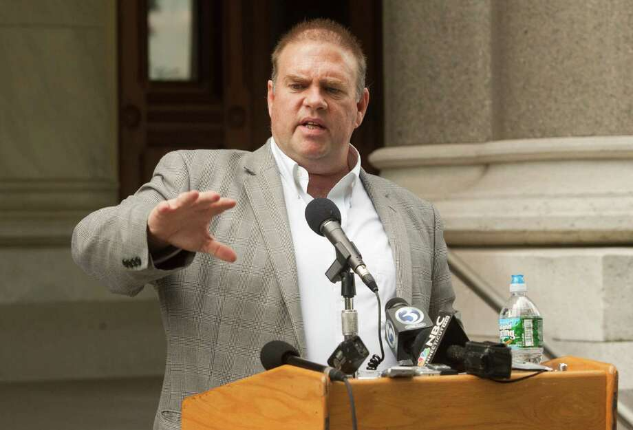 Tom Swan, left, campaign manager for Speaker of the House Christopher Donovan, Democratic candidate for Connecticut's 5th Congressional District, addresses the media after a campaign staff member was arrested by the FBI earlier in the week, Friday, June 1, 2012 outside the Capitol in Hartford, Conn. An FBI investigation into the finances of his congressional campaign will not keep Christopher Donovan from running or force him to step down as the Connecticut House speaker, his campaign manager said Friday. Photo: Christopher Zajac, Christopher Zajac/The Record-Journal Via AP / The Record-Journal