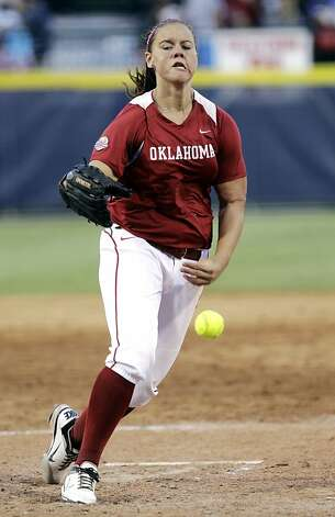Oklahoma's Keilani Ricketts pitches against California in the seventh inning of an NCAA Women's College World Series tournament softball game in Oklahoma City, Friday, June 1, 2012. Oklahoma won 3-0. Ricketts had 16 strikeouts in the game. (AP Photo/Sue Ogrocki) Photo: Sue Ogrocki, Associated Press