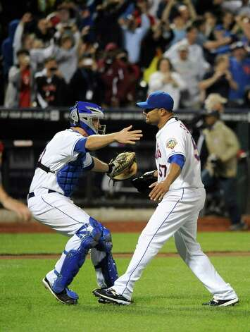 New York Mets catcher Josh Thole, left, runs to hug starting pitcher Johan Santana who threw a no-hitter against the St. Louis Cardinals in a baseball game on Friday, June 1, 2012, at Citi Field in New York. Photo: AP