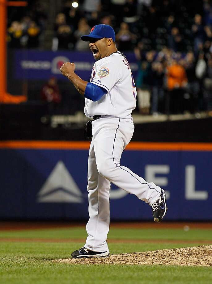 NEW YORK, NY - JUNE 01:  Johan Santana #57 of the New York Mets celebrates after pitching a no hitter against the St. Louis Cardinals at CitiField on June 1, 2012 in the Flushing neighborhood of the Queens borough of New York City. Johan Santana pitches the first no hitter in Mets history. Mets defeated the Cardinals 8-0.  (Photo by Mike Stobe/Getty Images) Photo: Mike Stobe, Getty Images