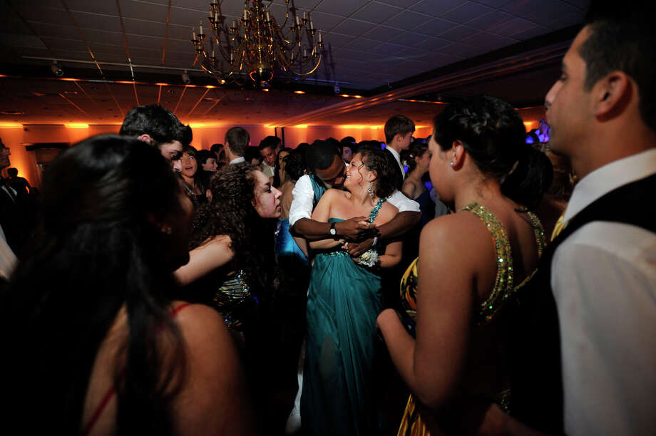 Seniors Joshua Adames and Nina Caraluzzi, center, embrace on the dance floor during the Bethel High School Senior Prom at The Amber Room Colonnade in Danbury on Friday, June 1, 2012. Photo: Jason Rearick / The News-Times