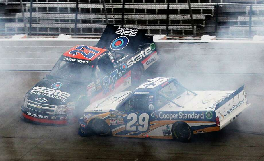 Jeb Burton (27) and Parker Kligerman (29) are involved in an accident  during the NASCAR Camping World Truck Series Lucas Oil 200. Photo: Rob Carr / 2012 Getty Images