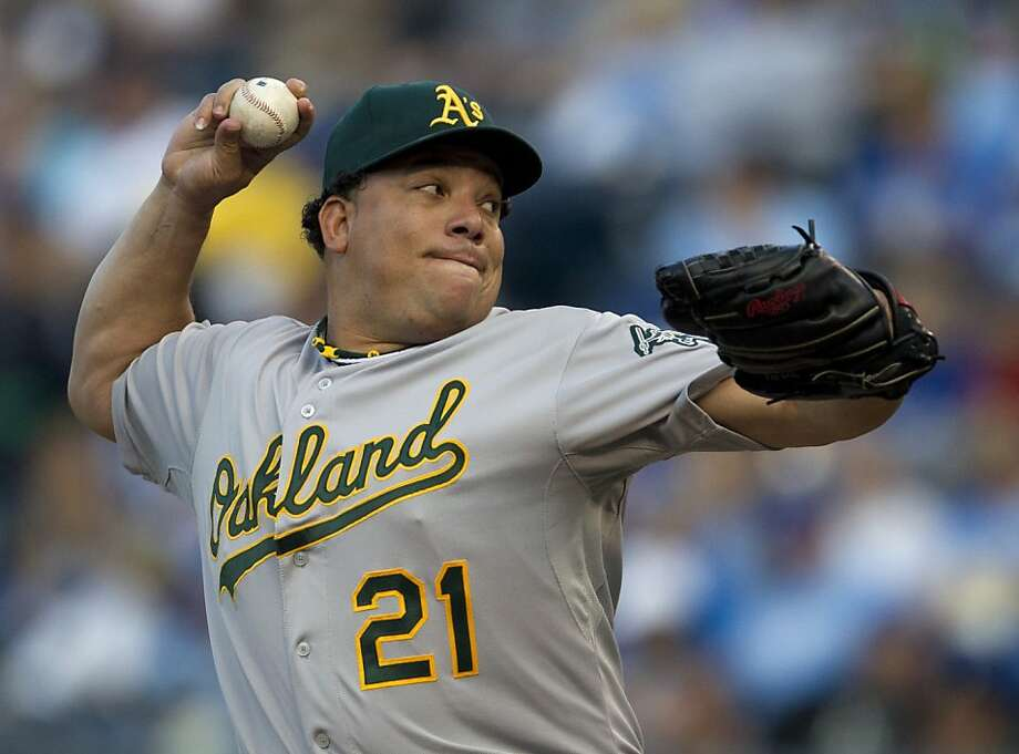Oakland Athletics starting pitcher Bartolo Colon throws to a Kansas City Royals batter during the first inning of a baseball game in Kansas City, Mo., Friday, June 1, 2012. (AP Photo/Orlin Wagner) Photo: Orlin Wagner, Associated Press