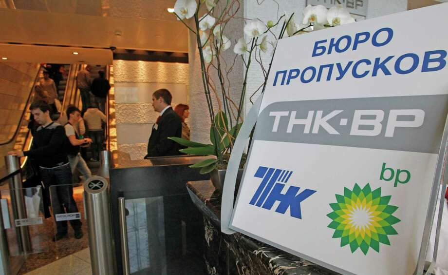 """A sign in Russian tells of a """"TNK-BP reception"""" Friday in Moscow. British oil company BP may sell its 50 percent stake in its Russian joint venture. Photo: Mikhail Metzel / AP"""