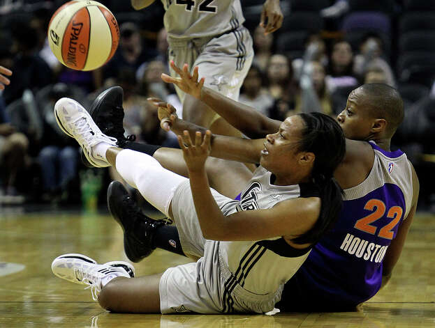 Jia Perkins wins the scramble on the floor for a loose ball against Charde Houston as the San antonio Silver Stars play the Phoenix Mercury at the AT&T Center on  June 1, 2012. Photo: Tom Reel, Express-News / ©2012 San Antono Express-News