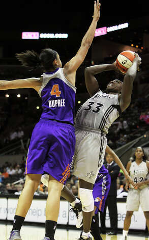 Stars forward Sophia Young is forced to put up a fade away against Candice Dupree as the San antonio Silver Stars play the Phoenix Mercury at the AT&T Center on  June 1, 2012. Photo: Tom Reel, Express-News / ©2012 San Antono Express-News