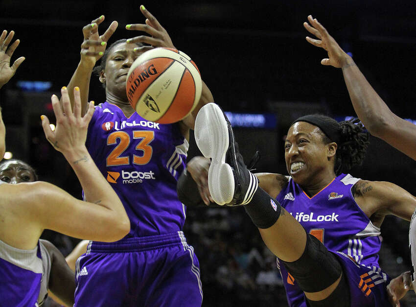 The ball gets loose from Mercury players Avery Warley (23) and Alexis Hornbuckle as the San antonio Silver Stars play the Phoenix Mercury at the AT&T Center on June 1, 2012.