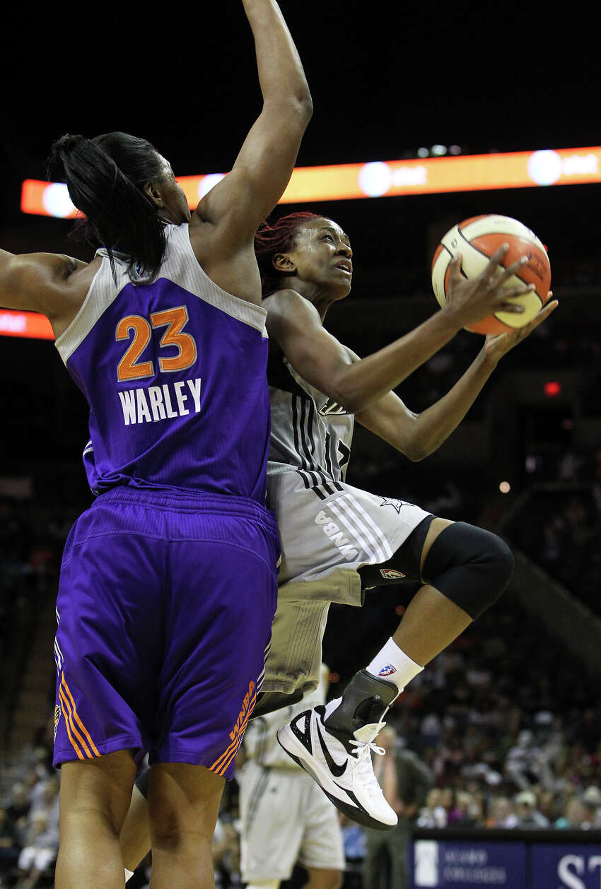 Stars guard Danielle Robinson goes for a layup on a fast break against Avery Warley as the San antonio Silver Stars play the Phoenix Mercury at the AT&T Center on June 1, 2012.